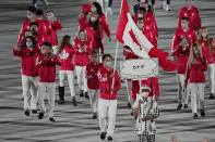 Miranda Ayim and Nathan Hirayama, of Canada, carry their country's flag during the opening ceremony in the Olympic Stadium at the 2020 Summer Olympics, Friday, July 23, 2021, in Tokyo, Japan. (AP Photo/David J. Phillip)