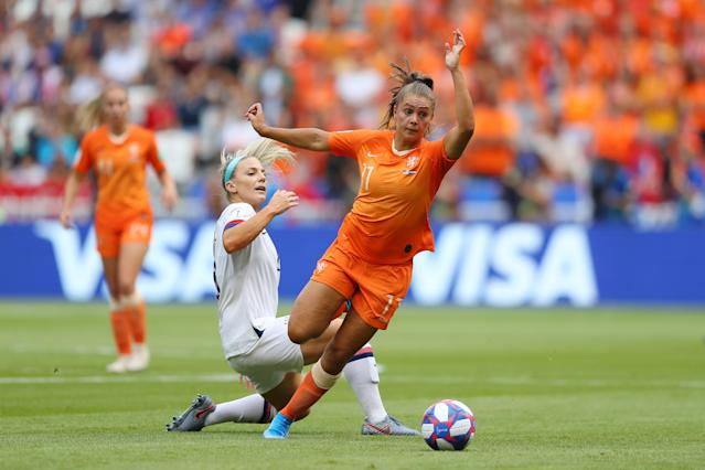 Lieke Martens of the Netherlands is challenged by Julie Ertz of the USA. (Credit: Getty Images)