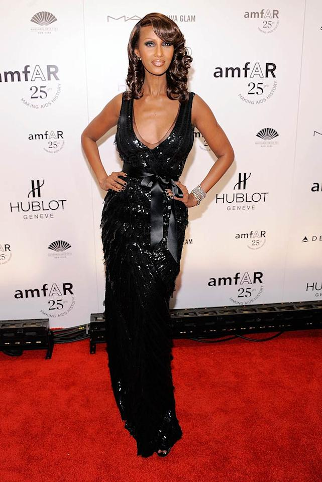 """Back in New York at the amfAR gala to kick off Fall Fashion Week, Somali supermodel Iman struck a pose in a to-die-for Oscar de la Renta dress, which featured thousands of sequins and a plunging neckline. Jemal Countess/<a href=""""http://www.wireimage.com"""" target=""""new"""">WireImage.com</a> - February 9, 2011"""