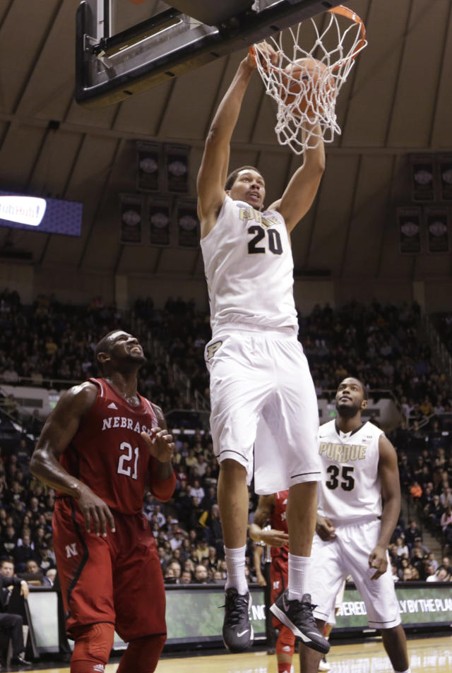 Purdue center A.J. Hammons (20) gets a dunk over Nebraska forward Leslee Smith(21) in the second half of an NCAA college basketball game in West Lafayette, Ind., Sunday, Jan. 12, 2014. Purdue defeated Nebraska 70-64. (AP Photo/Michael Conroy)