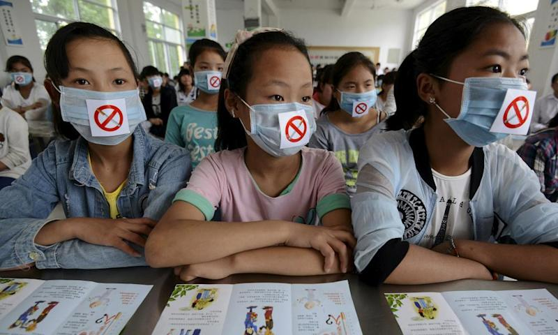 Students wearing masks with no smoking signs attend an anti-smoking lecture in Fuyang, China. More than a million deaths a year in China are from smoking related diseases.