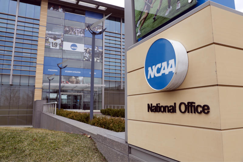 The national office of the NCAA in Indianapolis is shown Thursday, March 12, 2020. The NCAA canceled the men's and women's Division I basketball tournaments amid coronavirus fears on Thursday. (AP Photo/Michael Conroy)
