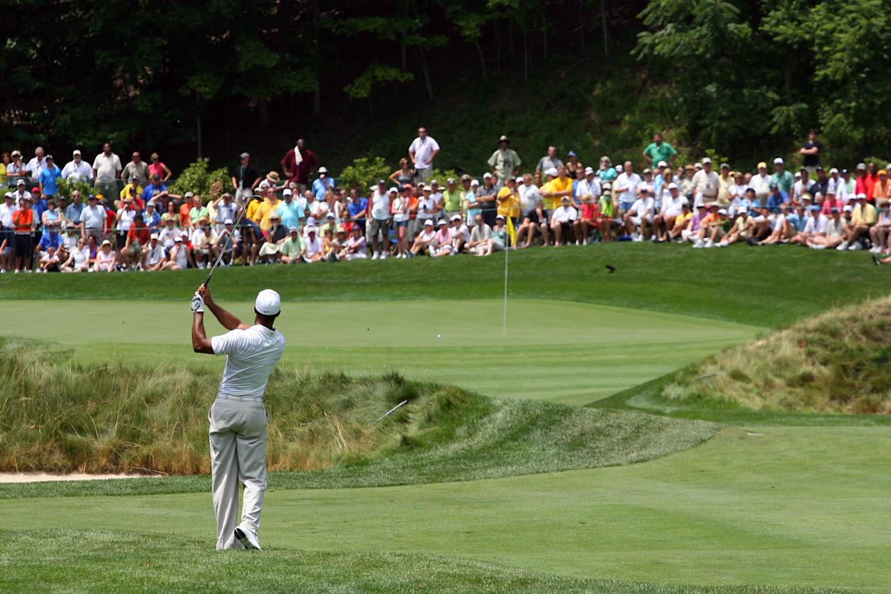 WHITE SULPHUR SPRINGS, WV - JULY 5: Tiger Woods hits his second shot on the ninth hole during the first round of the Greenbrier Classic at the Old White TPC on July 5, 2012 in White Sulphur Springs, West Virginia. (Photo by Hunter Martin/Getty Images)
