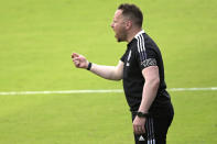 Vancouver Whitecaps head coach Marc Dos Santos calls out instructions during the first half of an MLS soccer match against Toronto FC, Saturday, April 24, 2021, in Orlando, Fla. (AP Photo/Phelan M. Ebenhack)
