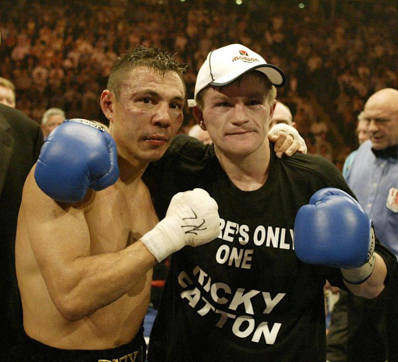 Ricky Hatton poses with Kostya Tszyu after the IBF light-welterweight match.