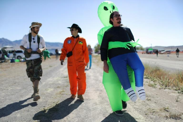 People walk at a 'Storm Area 51' spinoff event called 'Alienstock' in Rachel, Nevada