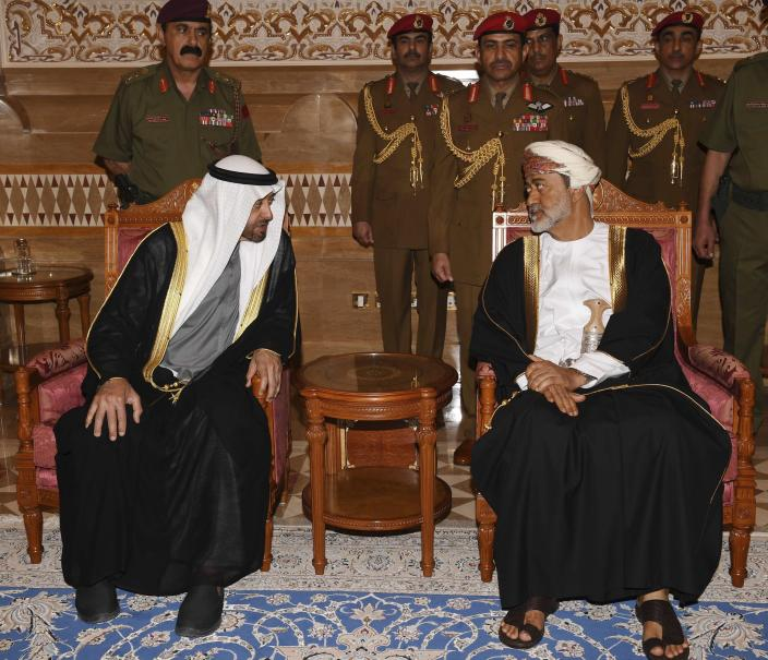 In this photo made available by Oman News Agency, Oman's new Sultan Haitham bin Tariq Al Said, right, receives Sheikh Mohammed bin Zayed Al Nahyan, the Crown Prince of the Emirate of Abu Dhabi and Deputy Supreme Commander of the United Arab Emirates Armed Forces, after his arrival to attend the late Sultan Qaboos official mourning ceremony in Muscat, Oman, Sunday, Jan. 12, 2020. (Oman News Agency via AP)