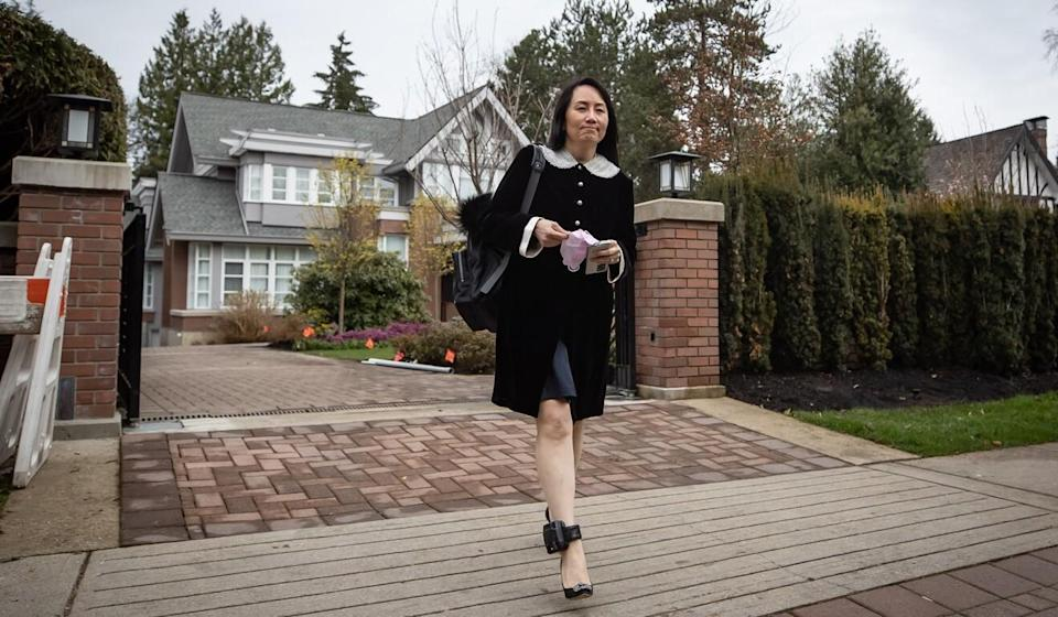 Meng Wanzhou leaves her home to attend a court hearing in Vancouver on Thursday. Photo: Bloomberg