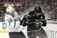 Dallas Stars' Reilly Smith, left, collides with Los Angeles Kings' Matt Greene during the first period of an NHL hockey game in Los Angeles, Sunday, April 21, 2013. (AP Photo/Jae C. Hong)