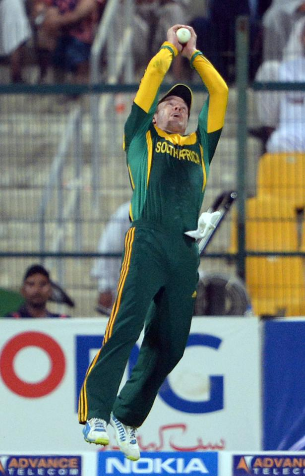 South African captain AB de Villiers takes a successful catch of Pakistani cricketer Sohaib Maqsood (unseen) during the fourth day-night international in Sheikh Zayed Cricket Stadium in Abu Dhabi on November 8, 2013. South Africa beat Pakistan by 28 runs, to take an unbeatable 3-1 lead in the five-match series. AFP PHOTO/ Asif HASSAN        (Photo credit should read ASIF HASSAN/AFP/Getty Images)
