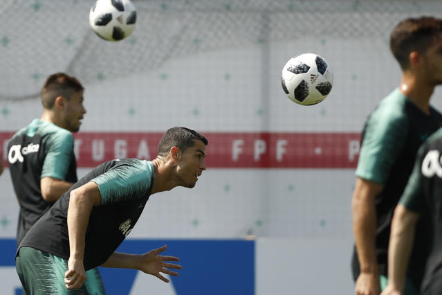 Portugal's Cristiano Ronaldo heads the ball during the training session of Portugal at the 2018 soccer World Cup in Kratovo, outskirts Moscow, Russia, Saturday, June 23, 2018. (AP Photo/Francisco Seco)