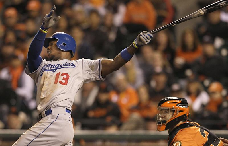 Los Angeles Dodgers' Hanley Ramirez (13) hits a two-run home run off of San Francisco Giants pitcher Sergio Romo during the 10th inning of a baseball game in San Francisco, Friday, July 27, 2012. (AP Photo/Jeff Chiu)