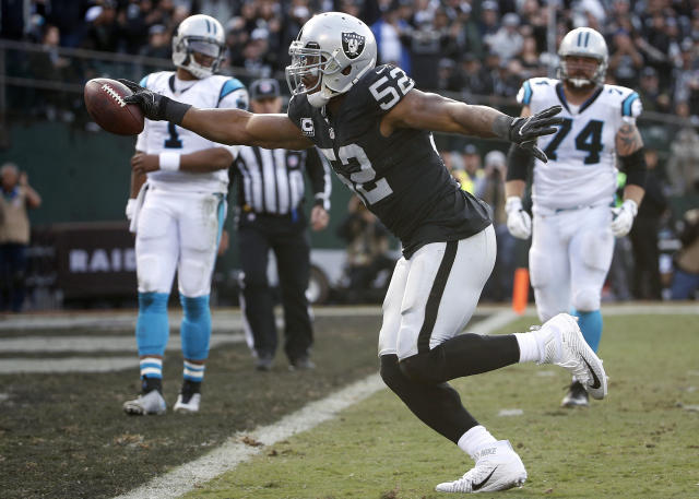 FILE - In this Nov. 27, 2016, file photo, Oakland Raiders defensive end Khalil Mack (52) scores a touchdown after intercepting a pass from Carolina Panthers quarterback Cam Newton (1) during the first half of an NFL football game in Oakland, Calif. The Chicago Bears have acquired star pass rusher Khalil Mack from the Raiders on Saturday, Sept. 1, 2018, in a massive trade that sends two first-round draft picks to Oakland. A person with direct knowledge of the trade told The Associated Press that Oakland will get first-round selections in 2019 and 2020, a sixth-rounder next year and a third-rounder in 2020. Oakland also included its second-round selection in 2020. The person spoke on condition of anonymity because the trade had not been announced. (AP Photo/Tony Avelar, File)