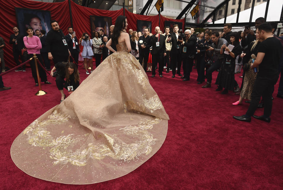 """Yifei Liu, star of the new live-action """"Mulan,"""" poses for photographers at the premiere of the film at the El Capitan Theatre, Monday, March 9, 2020, in Los Angeles. (AP Photo/Chris Pizzello)"""