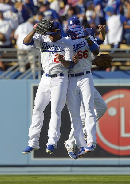 Los Angeles Dodgers' Carl Crawford (25), Yasiel Puig and Andre Ethier celebrate after Game 5 of the National League baseball championship series against the St. Louis Cardinals Wednesday, Oct. 16, 2013, in Los Angeles. The Dodgers won 6-4 and trail in the series 3-2. (AP Photo/Mark J. Terrill)