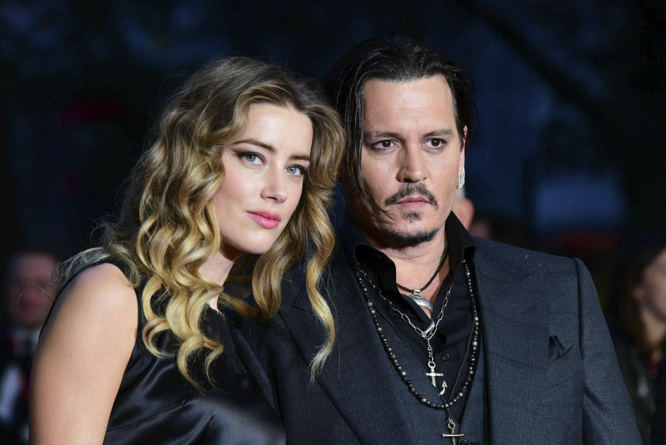 """Photo by: KGC-42/STAR MAX/IPx 2019 10/11/15 Amber Heard and Johnny Depp at the premiere of """"Black Mass"""". (London, England, UK)"""
