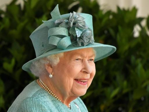 The 94-year-old monarch watched the pared back ceremony in the quadrangle of Windsor Castle from a dais