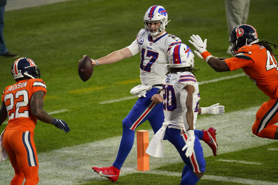Buffalo Bills quarterback Josh Allen scores a touchdown during the second half of an NFL football game against the Denver Broncos, Saturday, Dec. 19, 2020, in Denver. (AP Photo/Jack Dempsey)