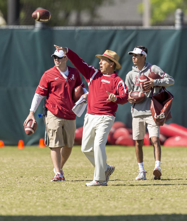 Alabama head coach Nick Saban, center, works with his players, throwing interception drills, during NCAA college spring football practice, Thursday, April 19, 2018, in Tuscaloosa, Ala. (Vasha Hunt/AL.com via AP)