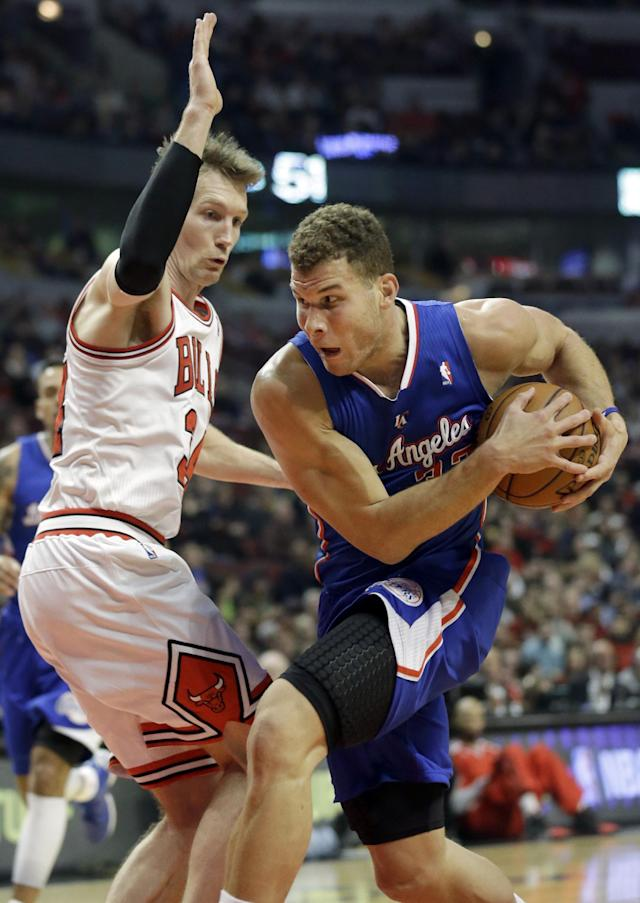 Los Angeles Clippers forward Blake Griffin, right, drives to the basket as Chicago Bulls guard Mike Dunleavy guards during the first half of an NBA basketball game in Chicago on Friday, Jan. 24, 2014. (AP Photo/Nam Y. Huh)
