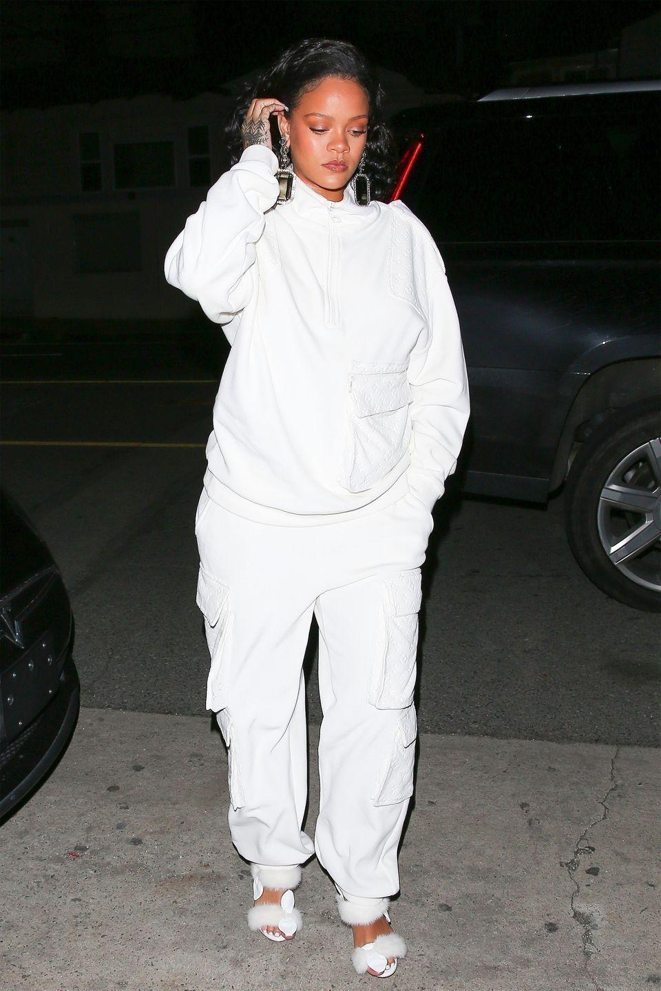 "<p>For dinner in LA, Rihanna dons a winter white Louis Vuitton sweatsuit with a custom-made pair of tonal Olgana Paris Celeste Mink Sandal. </p><p><a class=""link rapid-noclick-resp"" href=""https://fave.co/2WRRCFi"" rel=""nofollow noopener"" target=""_blank"" data-ylk=""slk:SHOP NOW"">SHOP NOW</a></p>"