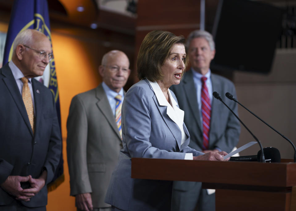 """Speaker of the House Nancy Pelosi, D-Calif., joined from left by Rep. Paul Tonko, D-N.Y., chair of the Subcommittee on Environment & Climate Change, House Transportation and Infrastructure Committee Chair Peter DeFazio, D-Ore., and House Energy and Commerce Chairman Frank Pallone, D-N.J., talks during a news conference to discuss the """"INVEST in America Act,"""" a five-year surface transportation bill, which directs federal investments in roads, bridges, transit, and rail, at the Capitol in Washington, Wednesday, June 30, 2021. (AP Photo/J. Scott Applewhite)"""