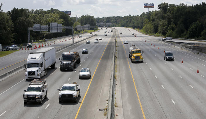 <p>Both sides of Interstate 26 in North Charleston, S.C., flow westbound toward Columbia, S.C., Tuesday, Sept. 11, 2018, in preparation for Hurricane Florence. (Photo: Mic Smith/AP) </p>