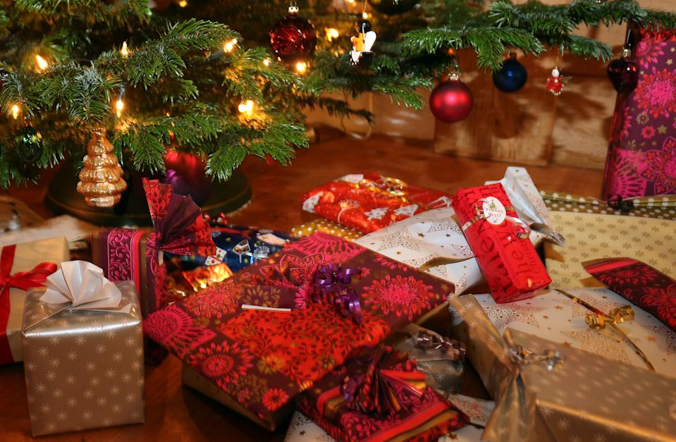 24 December 2018, Bavaria, Kaufbeuren: Packed Christmas presents lie under a Christmas tree. Photo: Karl-Josef Hildenbrand/dpa (Photo by Karl-Josef Hildenbrand/picture alliance via Getty Images)