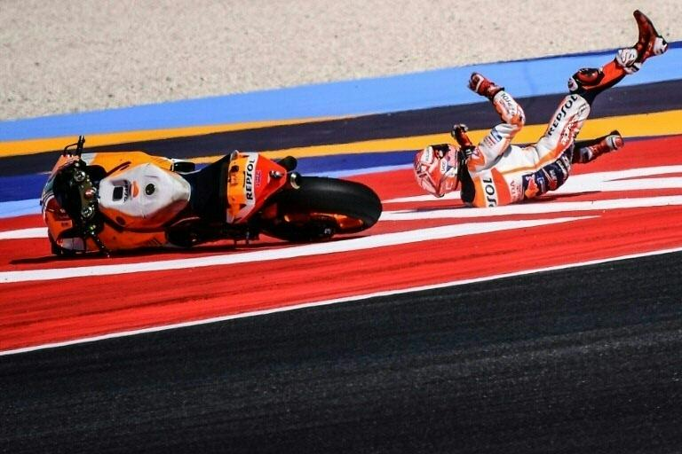 World champion Marc Marquez falls during the final free practice session at the San Marino MotoGP. (AFP Photo/Marco Bertorello)
