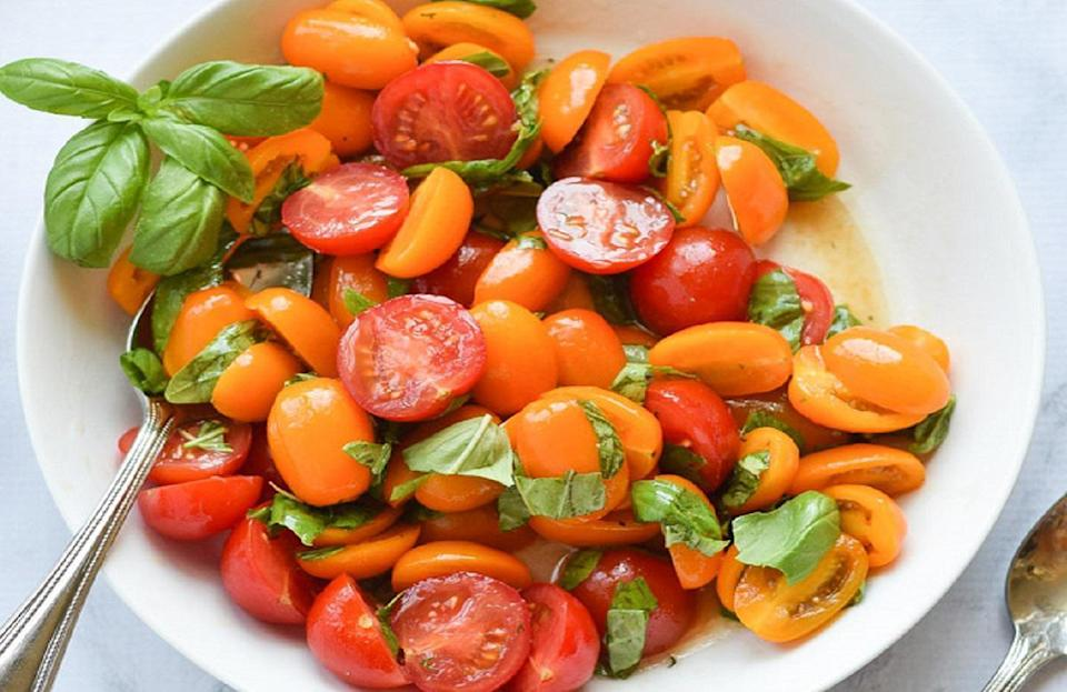 """<p>If your cherry tomato plant exploded this summer with tons of fresh fruit (<a href=""""https://www.thedailymeal.com/eat/foods-not-what-you-think?referrer=yahoo&category=beauty_food&include_utm=1&utm_medium=referral&utm_source=yahoo&utm_campaign=feed"""" rel=""""nofollow noopener"""" target=""""_blank"""" data-ylk=""""slk:yes, tomatoes are a fruit"""" class=""""link rapid-noclick-resp"""">yes, tomatoes are a fruit</a>!), then let them shine in this easy tomato salad, which uses three cups of tomatoes.</p> <p><a href=""""https://www.thedailymeal.com/recipes/marinated-tomato-basil-salad-recipe-0?referrer=yahoo&category=beauty_food&include_utm=1&utm_medium=referral&utm_source=yahoo&utm_campaign=feed"""" rel=""""nofollow noopener"""" target=""""_blank"""" data-ylk=""""slk:For the Marinated Tomato Basil Salad recipe, click here."""" class=""""link rapid-noclick-resp"""">For the Marinated Tomato Basil Salad recipe, click here.</a></p>"""