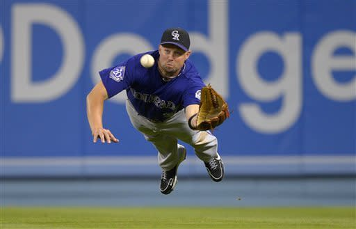 Colorado Rockies right fielder Michael Cuddyer makes a catch on a ball hit by Los Angeles Dodgers' Luis Cruz during the eighth inning of their baseball game, Tuesday, April 30, 2013, in Los Angeles. (AP Photo/Mark J. Terrill)