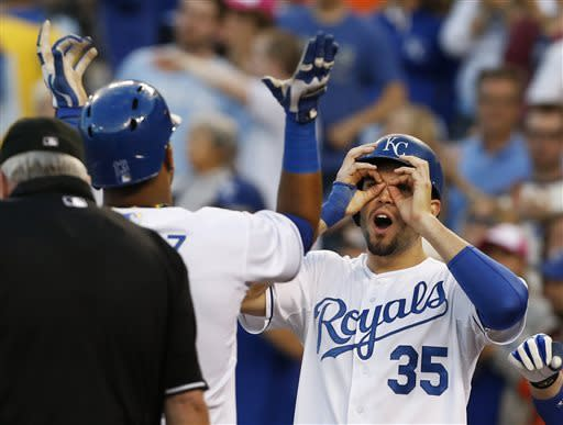 Kansas City Royals' Eric Hosmer (35) greets teammate Salvador Perez following a two-run home run by Perez during the fourth inning of a baseball game against the Houston Astros at Kauffman Stadium in Kansas City, Mo., Friday, June 7, 2013. (AP Photo/Orlin Wagner)