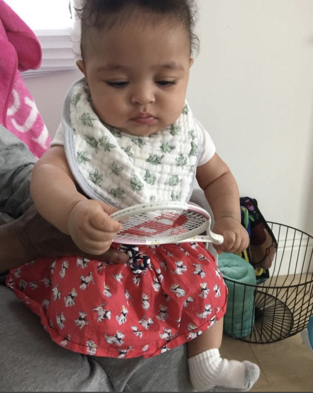 "<p>""Olympia Ohanian, at match point, championship point, even without her shoes she's hard to beat,"" the tennis pro captioned this snap of her precious daughter, Alexis Olympia, holding a tiny Wilson tennis racket. ""Serving now for her 12th Wimbledon title. 3 more than her mum Serena."" (Photo: <a href=""https://www.instagram.com/p/BeqOVmUhSES/?taken-by=serenawilliams"" rel=""nofollow noopener"" target=""_blank"" data-ylk=""slk:Serena Williams via Instagram"" class=""link rapid-noclick-resp"">Serena Williams via Instagram</a>) </p>"