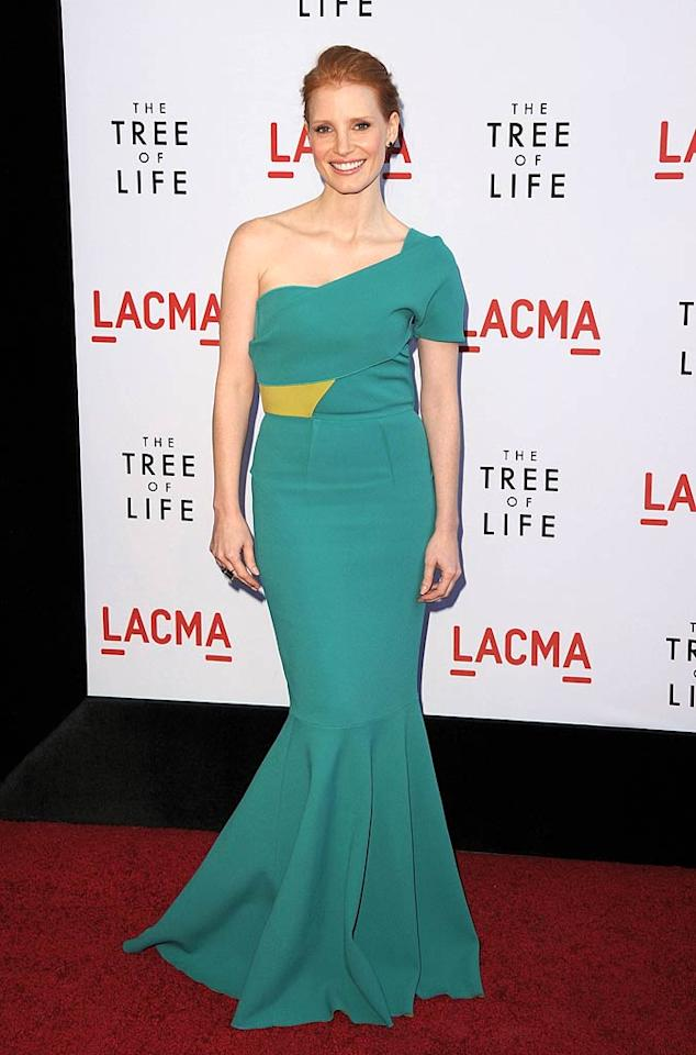 "Following in the dynamic duo's footsteps was Brad's ""Tree of Life"" co-star, Jessica Chastain, who also impressed in a silhouette-accentuating mermaid gown, courtesy of French fashion designer Roland Mouret. Jason Merritt/<a href=""http://www.gettyimages.com/"" target=""new"">GettyImages.com</a> - May 24, 2011"
