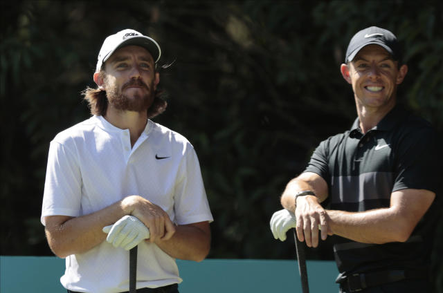 Rory McIlroy of Northern Ireland, right, speaks with Tommy Fleetwood of England as they wait at the second tee off during the first round of the WGC-Mexico Championship golf tournament, at Chapultepec Golf Club in Mexico City, Mexico City, Thursday, Feb. 20, 2020.(AP Photo/Fernando Llano)