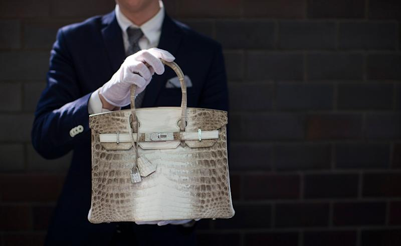 An employee holds an Hermes diamond and Himalayan Nilo Crocodile Birkin handbag at Heritage Auctions offices in Beverly Hills, CA on Sept. 22, 2014. The handbag has 242 diamonds with a total of 9.84 carats.
