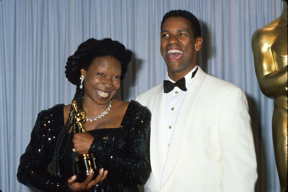 Whoopi Goldberg holds her Oscar while posing with presenter Denzel Washington at the 1991 Academy Awards.  (Photo: Time Life Pictures/DMI/The LIFE Picture Collection via Getty Images)