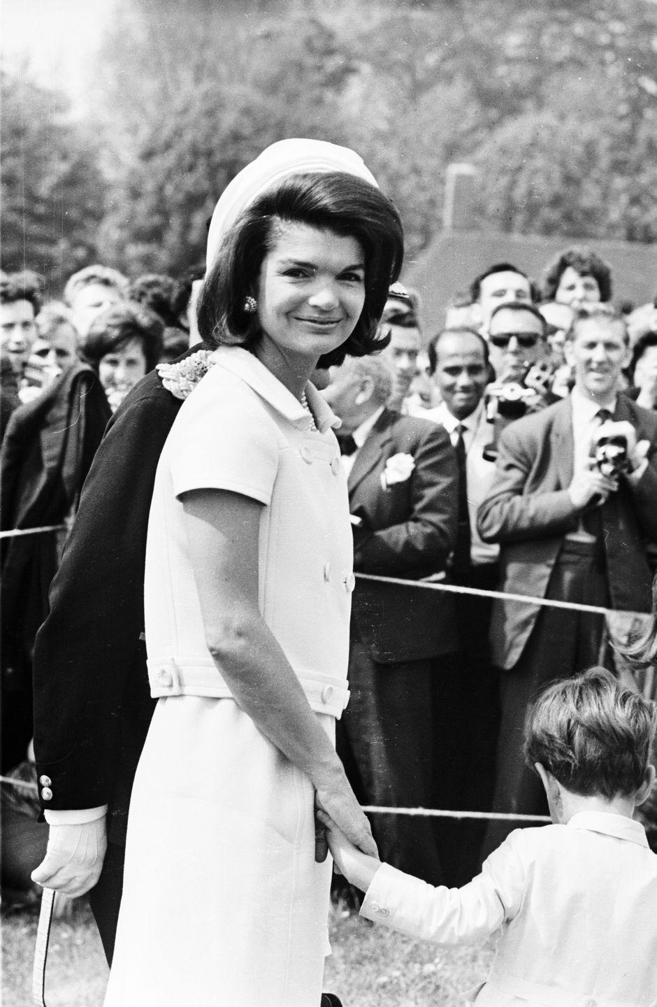 <p>Jackie attends the dedication of a memorial to her late husband in Surrey, England. </p>