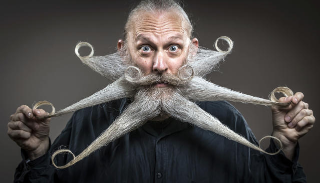 <p>Aarne Bielefeld attends the fourth British Beard and Moustache Championships at the Empress Ballroom, Winter Gardens, Blackpool. (PA Images) </p>