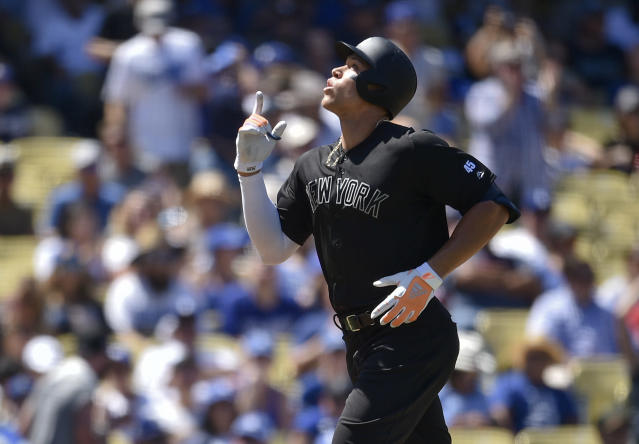 New York Yankees' Aaron Judge celebrates while crossing home plate after hitting a solo home run during the fourth inning of a baseball game against the Los Angeles Dodgers in Los Angeles, Saturday, Aug. 24, 2019. (AP Photo/Kelvin Kuo)