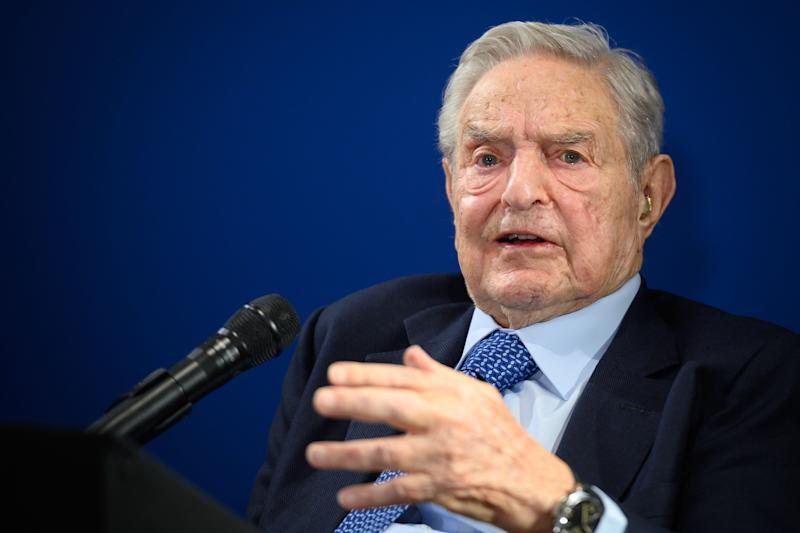 Investor and philanthropist George Soros goes after Donald Trump and Facebook at the World Economic Forum in Davos on Thursday. (Photo: FABRICE COFFRINI via Getty Images)