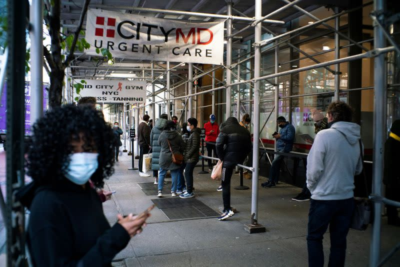 People wait in line outside of a coronavirus disease (COVID-19) testing center in New York City, New York