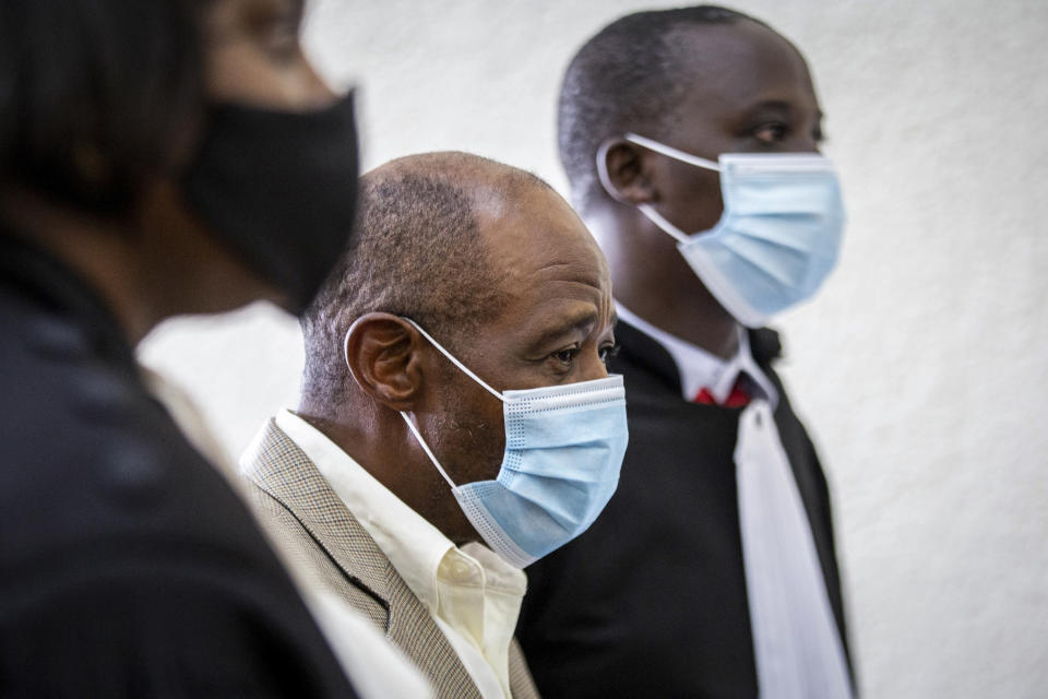 """FILE - In this Monday, Sept. 14, 2020 file photo, Paul Rusesabagina, center, whose story inspired the film """"Hotel Rwanda"""" for saving people from genocide, appears at the Kicukiro Primary Court in the capital Kigali, Rwanda. A court in Rwanda said Monday, Sept. 20, 2021 that Rusesabagina, who boycotted the announcement after declaring he didn't expect justice in a trial he called a """"sham"""", is guilty of terror-related offenses. (AP Photo, File)"""