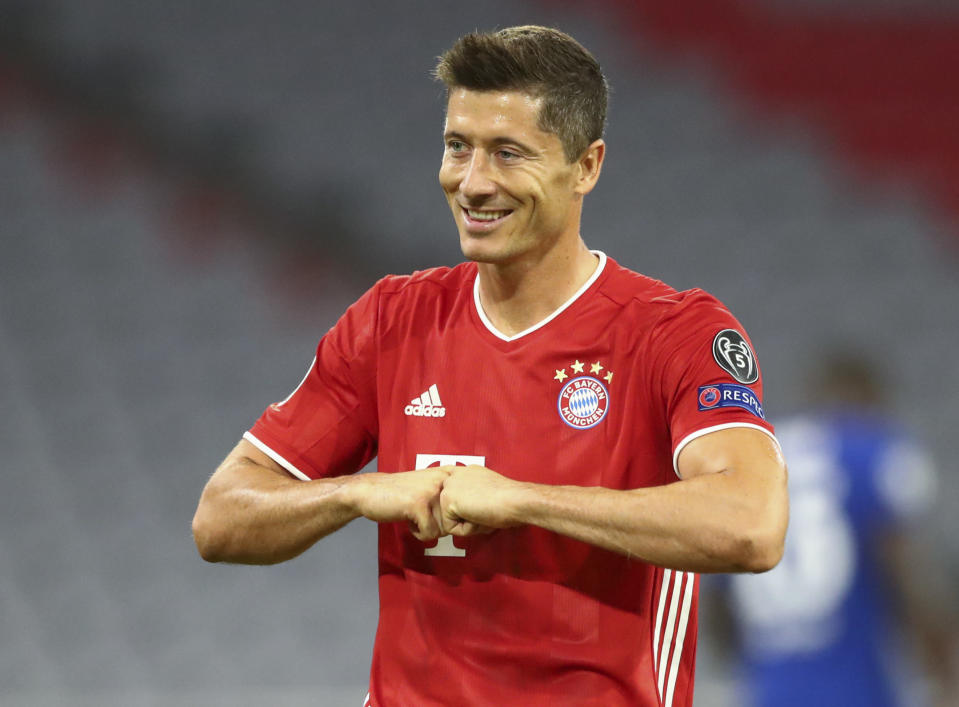 Bayern's Robert Lewandowski celebrates after scoring his team's first goal from the penalty spot during the Champions League round of 16 second leg soccer match between Bayern Munich and Chelsea at Allianz Arena in Munich, Germany, Saturday, Aug. 8, 2020. (AP Photo/Matthias Schrader)