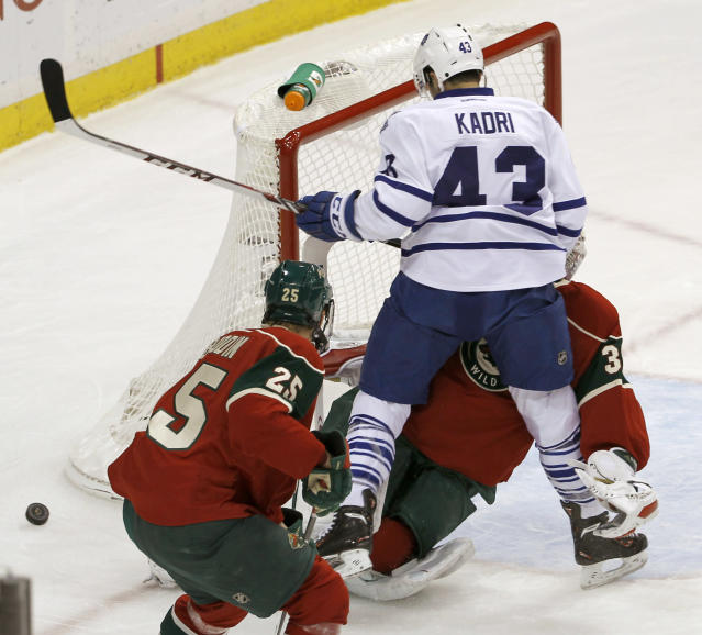Toronto Maple Leafs center Nazem Kadri (43) collides with Minnesota Wild goalie Niklas Backstrom, of Finland, during the first period of an NHL hockey game in St. Paul, Minn., Wednesday, Nov. 13, 2013. Backstrom left the game later in the period. (AP Photo/Ann Heisenfelt)