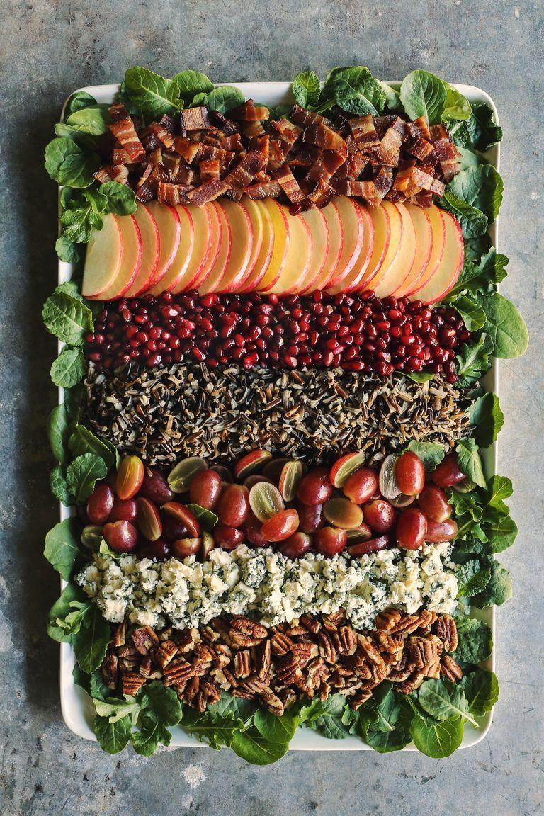 """<p>A platter of this layered salad is sure to be a holiday show-stopper. Serve it with the maple-mustard dressing for even more fall flavor.</p><p><strong><a href=""""https://www.thepioneerwoman.com/food-cooking/recipes/a100072/holiday-wild-rice-salad/"""" rel=""""nofollow noopener"""" target=""""_blank"""" data-ylk=""""slk:Get the recipe."""" class=""""link rapid-noclick-resp"""">Get the recipe.</a></strong></p>"""