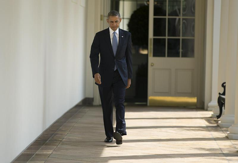 President Barack Obama walks along the West Wing Colonnade towards the Oval Office of the White House in Washington, Tuesday, Sept. 10, 2013, ahead of his daily briefing. Obama will deliver a speech on Syria from the East Room in an address to the nation this evening. (AP Photo/Pablo Martinez Monsivais)