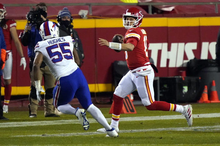 Kansas City Chiefs quarterback Patrick Mahomes is pressured by Buffalo Bills defensive end Jerry Hughes (55) while throwing a pass during the first half of the AFC championship NFL football game, Sunday, Jan. 24, 2021, in Kansas City, Mo. (AP Photo/Jeff Roberson)