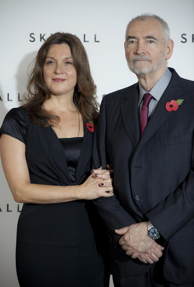 "FILE - In this Nov. 3, 2011 file photo, producers Barbara Broccoli, left, and Michael G. Wilson pose for photographs at a photo-call for the new James Bond film, ""Skyfall,"" at a central London restaurant venue. The film is the 23rd in the Bond series. With ""Skyfall,"" which premieres Oct. 23, 2012 in London, the family made another tough choice: casting 31-year-old Ben Whishaw as Bond's gadget guru, Q.  (AP Photo/Joel Ryan, File)"