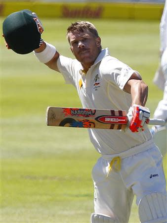 Australia's David Warner celebrates his century on the first day of their third test cricket match against South Africa in Cape Town, March 1, 2014. REUTERS/Mike Hutchings